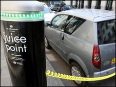 Electric car being charged in central London