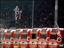 Evel Knievel attempts to jump over 13 buses at Wembley Stadium in May 1975