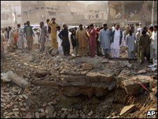 The blast left a huge crater in the Dera Ghazi Khan market