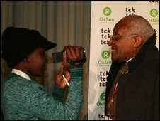 Archbishop Desmond Tutu is filmed by a young reporter at the UN Climate Change Conference in Copenhagen