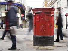 Letter box with people walking by