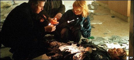 "William Petersen, Paul Guilfoyle, and Marg Helgenberger, investigate a bomb explosion in a scene from the first season of ""CSI: Crime Scene Investigation."""