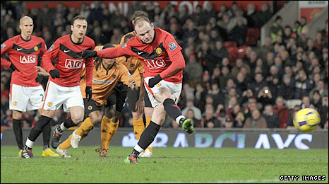 Wayne Rooney scores his penalty against Wolves