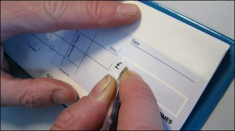 A person writing a cheque