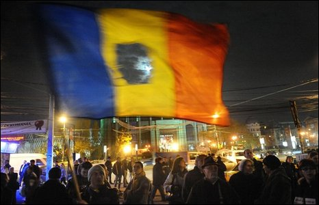 Romanians waving revolution flag  in December 2009