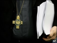 Archbishop of Dublin Diarmuid Martin holds a copy of the Murphy report