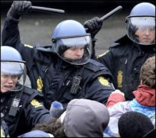 Baton-wielding police