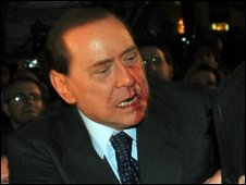 Italian Prime Minister Silvio Berlusconi after being struck in face