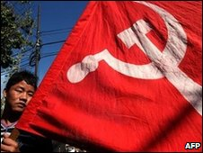 Maoist supporter with a party flag