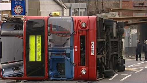 Bus on its side after collision
