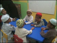 Children being taught Islamic scripture in Jakarta