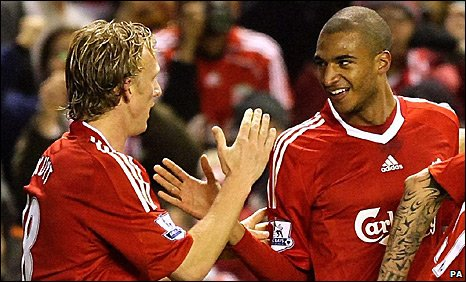 Liverpool striker David Ngog (right) is congratulated by Dirk Kuyt after his goal against Wigan