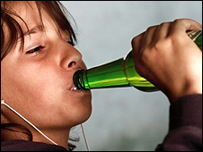 A boy (model) drinking alcohol
