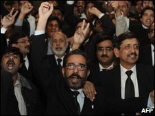 Pakistani lawyers celebrate the Supreme Court ruling in Islamabad on December 16, 2009