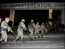 Soldiers arrive near an apartment complex in Cuernavaca, Mexico