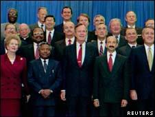 Margaret Thatcher alongside other world leaders in 1990