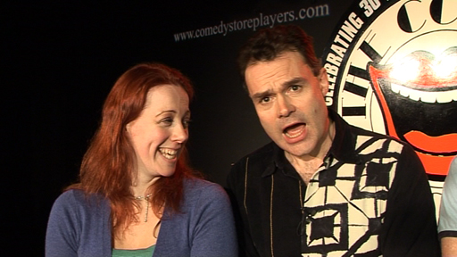 Neil Mullarkey and a member of the Comedy Store audience