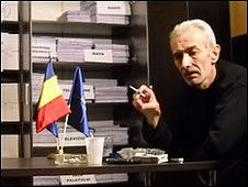 "Teodor Maries in front of the documents he has received from the authorities (picture courtesy of 21 December 1989"" association)"