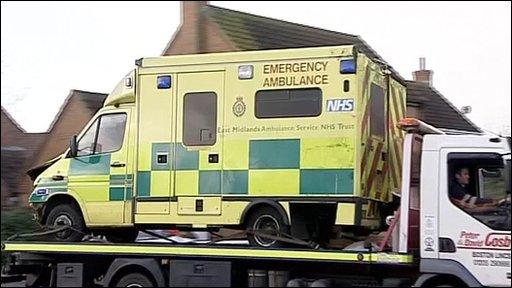 Ambulance on flat bed truck