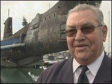 Jim Onions next to HMS Alliance