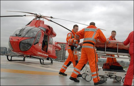 An air ambulance and staff