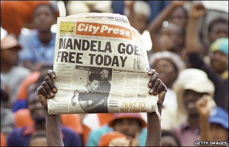 a jubilant Sowetan holding up a newspaper announcing the release of African National Congress (ANC) leader Nelson Mandela
