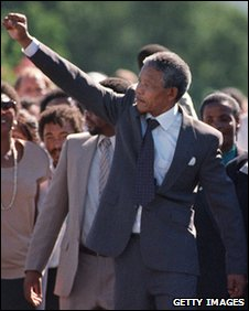 Mandela raises his fist as he walks free from prison in 1991