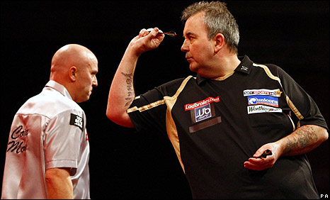 Colin Monk (left) was no match for Phil Taylor