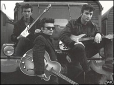 George Harrison, Stuart Sutcliffe, and John Lennon of the Beatles
