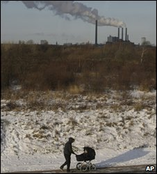A power plant as someone pushes a pram in Copenhagen, on 19 December 2009
