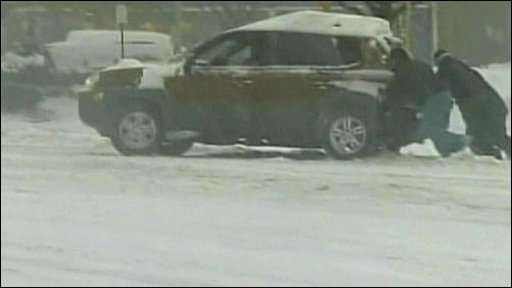 Pushing car in the snow