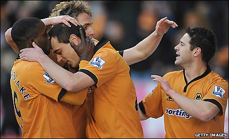 Wolves midfielder Nenad Milijas (second left) is congratulated after his opener for his side against Burnley