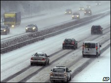 Cars driving in a motorway during a snowfall in Gelsenkirchen, Germany