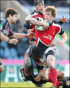 Andrew Trimble of Ulster finds his run halted in the match against Stade Francais