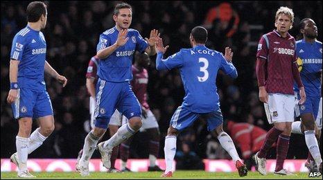Frank Lampard (centre-left) celebrates with Ashley Cole (centre-right)