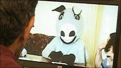 Man watches donkey video