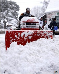 Mini snow plough clearing snow
