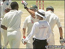 West Indies spinner Sulieman Benn (left) in a confrontation with Australia's Bard Haddin (centre) and Mitchell Johnson (right)