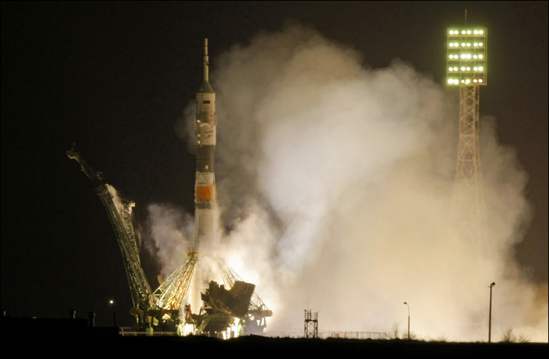 A Soyuz-FG rocket booster with Soyuz TMA-17 space ship