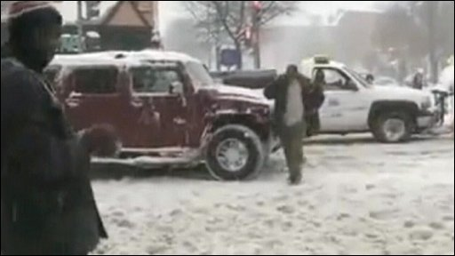 Officer pulls a gun out during a snowball fight