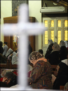 Chritians pray at St Michael's church Cairo