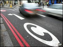 Cars driving past the congestion charge zone in London