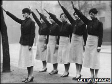 Women Blackshirts on parade in Liverpool give the fascist salute