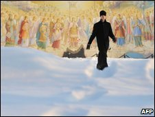 A priest walks in snow in Kiev, 21 December