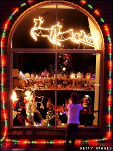 A little girl peering through a decorated shop window (Getty Images)