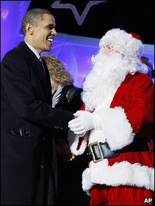 President Obama meets Father Christmas (Image: AP)