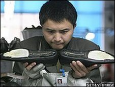 Chinese worker in a shoe factory