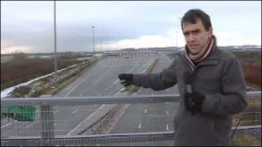 Wyre Davies on a bridge over the M4