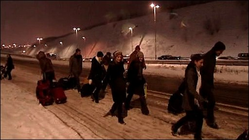 Passengers walking in snow