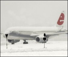 Plane covered with snow at Milan's Linate airport, 22 Dec
